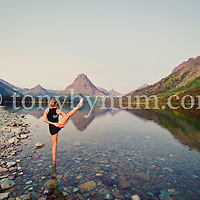 woman yoga outdoors standing in dramatic reflective lake