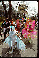 Kids march in Earth Day parade in homemade bird and insect costumes; Forest Park, St. Louis Missouri