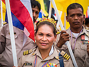 05 MAY 2104 - BANGKOK, THAILAND: Thai civil servants who support the anti-government movement march down Sanam Chai Road past the Grand Palace in Bangkok. Thousands of Thais packed the area around Sanam Luang and the Grand Palace Monday evening for a special ceremony to mark Coronation Day, which honored the 64th anniversary of the coronation of Bhumibol Adulyadej, the King of Thailand. Many of the people also support the anti-government movement led by Suthep Thaugsuban. Most of the anti-government protesters are conservative supporters of the monarchy.    PHOTO BY JACK KURTZ