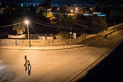 6 October 2018, Jericho, Occupied Palestinian Territories: A group of girls walk down the streets of Jericho at night.