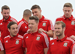 DINARD, FRANCE - Tuesday, June 7, 2016: Wales' James Chester playfully massages the shoulders of Wales goalkeeper Wayne Hennessey as players prepare for a team group photograph at the Novotel Thalasso Dinard ahead of the start of the UEFA Euro 2016 tournament. (Pic by Paul Greenwood/Propaganda)