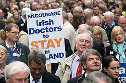 Repro Free: 24/09/2014 Dr Bill Moore from Waterford is pictured as for the first time in the history of the state, GPs have been motivated to protest as patient safety is now at risk. GPs (as part of NAGP/ National Association of General Practitioners) outside Leinster House. Picture Andres Poveda