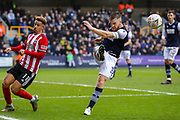 Millwall defender Alex Pearce (15) clears the ball away from Sheffield United forward Callum Robinson (11) during The FA Cup match between Millwall and Sheffield United at The Den, London, England on 25 January 2020.