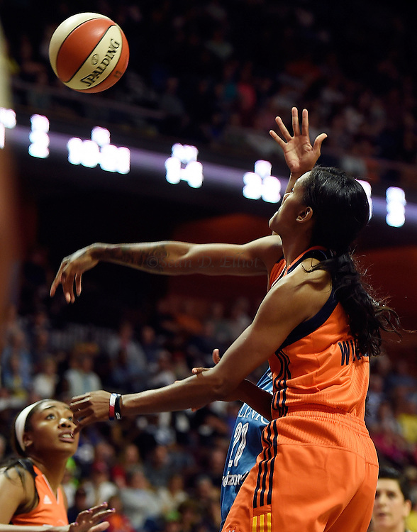 7/7/16 :: SPORTS :: GRIFFEN :: Connecticut rookie Courtney Williams blocks a shot attempt by Minnesota's Renee Montgomery (21) in WNBA action Thursday, July 7, 2016 at Mohegan Sun Arena. (Sean D. Elliot/The Day)