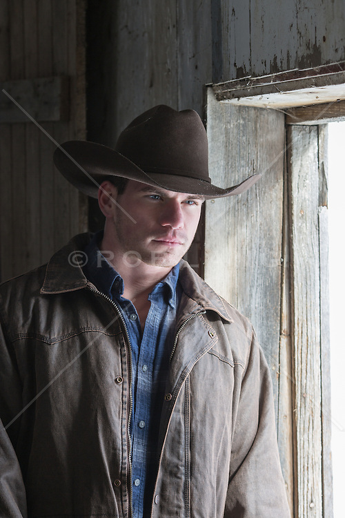 portrait of a rugged and handsome cowboy with blue eyes