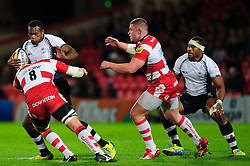 Fiji Full Back (#15) Metuisela Talebula  runs at Gloucester Number 8 (#8) Peter Buxton (capt) during the first half of the match - Photo mandatory by-line: Rogan Thomson/JMP - Tel: Mobile: 07966 386802 13/11/2012 - SPORT - RUGBY - Kingsholm Stadium - Gloucester. Gloucester Rugby v Fiji - International Friendly