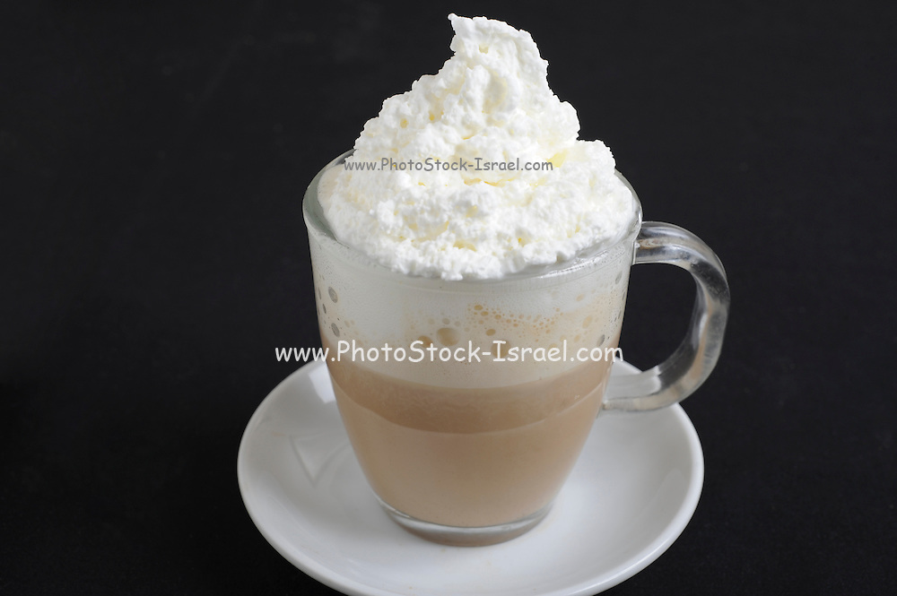 cup of Hot chocolate flavoured milk with whipped cream On black Background