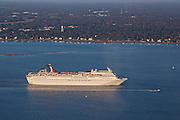 Aerial showing Carnival Cruise Lines ship departing Charleston Harbor in Charleston, SC.