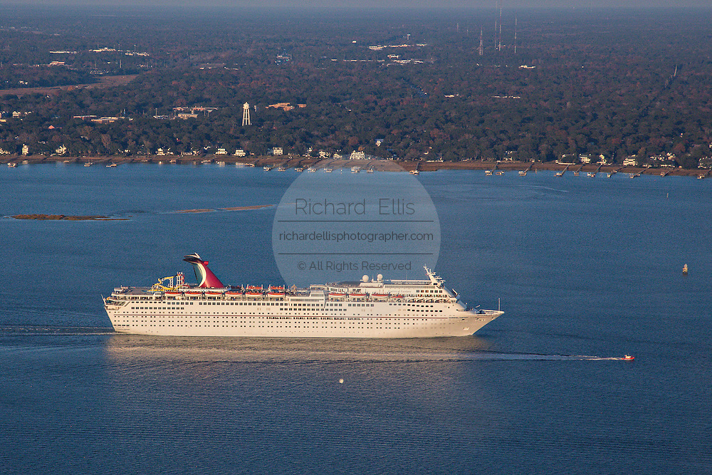 Aerial showing Carnival Cruise Lines ship departing Charleston Harbor in Charleston, SC.