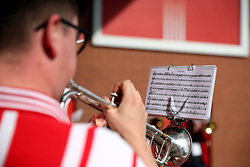 The Saints Brass band perform outside the ground