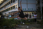 Aryane da Silva of the Manguinhos community ballet, poses for a picture in the degraded surroundings of the Biblioteca Parque public library in Manguinhos neighbourhood in Rio de Janeiro, Brazil, Monday, June 11, 2018.  The Manguinhos community ballet has been a reprieve from the violence and poverty that afflicts its namesake neighborhood for hundreds of girls who have benefitted from free dance classes since 2012. (Dado Galdieri for The New York Times)
