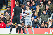 Julian Jeanvier (Brentford) in a ruck with Tom Lawrence (Derby County) during the EFL Sky Bet Championship match between Brentford and Derby County at Griffin Park, London, England on 6 April 2019.