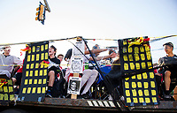 The Sophomore class of DC Villains ride on their Gotham City float during Laconia High School's Homecoming parade Friday afternoon.  (Karen Bobotas/for the Laconia Daily Sun)