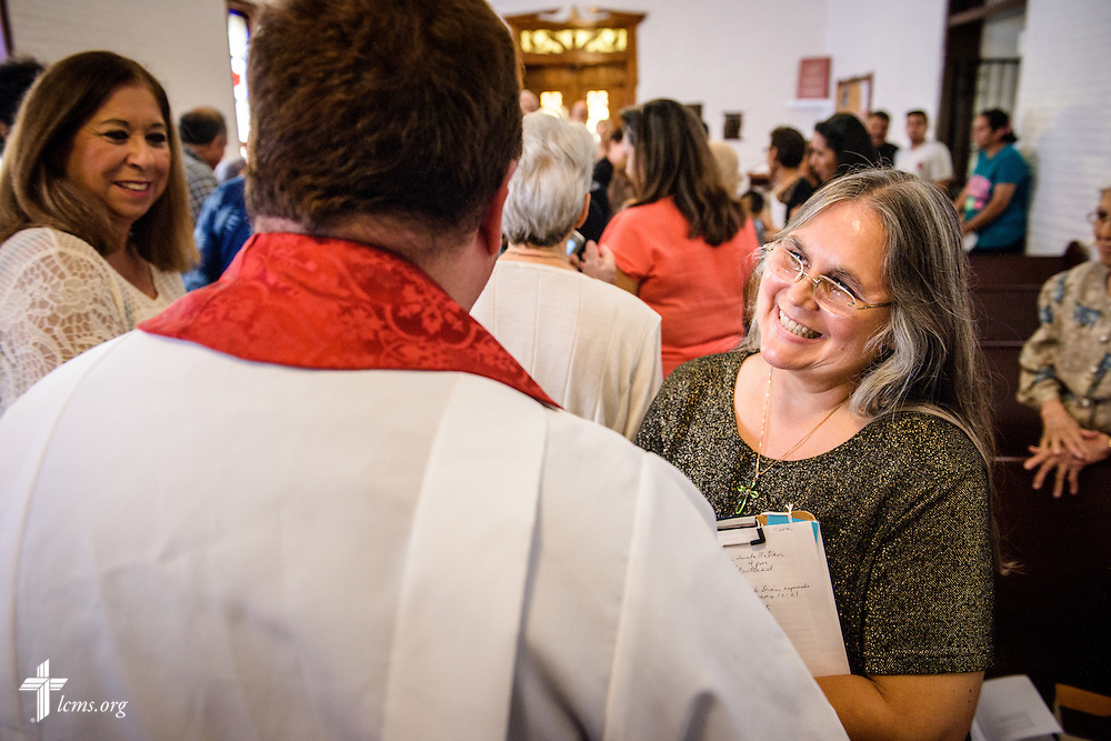 Parishioner Sara Zambrano welcomes the Rev. Dr. Antonio Lopez, new national missionary pastor at El Calvario Lutheran Church on Sunday, July 31, 2016, in Brownsville, Texas. LCMS Communications/Erik M. Lunsford