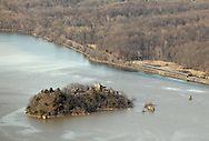 Cornwall, New York - A view of Bannerman's Island Arsenal on Pollepel Island in the Hudson River from Storm King Mountain State Park on March 27, 2010. An Amtrak passenger train heading north is visible on the east bank of the river at right.