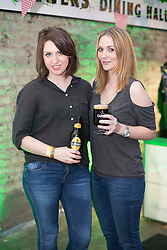 Repro Free: 14/03/2014 Faye McGillicuddy and Frances Neeson pictured at the Guinness Storehouse St. Patrick's Festival. The four day festival is showcasing some of Ireland's best music, food and rugby over the weekend including an intimate performance by acclaimed rock band The Coronas. Enjoy GUINNESS sensibly. Visit drinkaware.ie Pic Andres Poveda