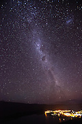 Milky Way above the night lights of Tekapo, New Zealand