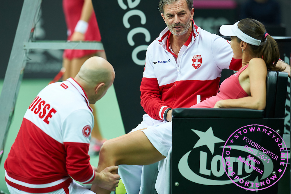 Swiss physiotherapist helps injured Martina Hingis from Switzerland during the Fed Cup / World Group Play Off tennis match between Poland and Switzerland on April 19, 2015 in Zielona Gora, Poland<br /> Poland, Zielona Gora, April 19, 2015<br /> <br /> Picture also available in RAW (NEF) or TIFF format on special request.<br /> <br /> For editorial use only. Any commercial or promotional use requires permission.<br /> <br /> Adam Nurkiewicz declares that he has no rights to the image of people at the photographs of his authorship.<br /> <br /> Mandatory credit:<br /> Photo by &copy; Adam Nurkiewicz / Mediasport