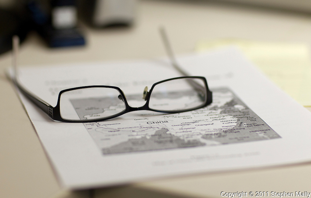 A pair of glasses sit on a map of China in the office of Jon Edwards, Associate Dean of Admission and Coordinator of International Admission, at Grinnell College in Grinnell, Iowa on Tuesday February 1, 2011.