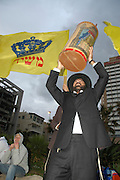 "Israel, Tel Aviv, Chabad Lubavitch Hasidim protesting the annual gay pride parade with a ""Salvation"" parade including Torah scrolls and flags proclaiming the  messiah"