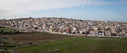 16 February 2020, Irbid, Jordan: View of the densely populated Al Shaheed Azmi Almofti Camp in Irbid, originally grown out of a refugee camp for Palestinian refugees, it is now also home to many Syrian refugees to Jordan.