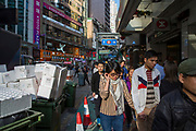 Pedestrians shopping on a sunny day near Kyoto Plaza on Lockhart Road, Hong Kong. (photo by Andrew Aitchison / In pictures via Getty Images)