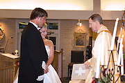 The wedding of Honea Busch and Aaron Lips at St. Anselm in Madisonville, Louisiana and reception at the Tchefuncta Country Club on May 28, 2005.