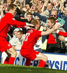 LIVERPOOL, ENGLAND - Saturday, April 19, 2003: Liverpool's Danny Murphy celebrates scoring the winning goal against Everton during the Merseyside Derby Premiership match at Goodison Park. (Pic by David Rawcliffe/Propaganda)