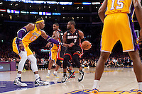17 January 2013: Guard (3) Dwyane Wade of the Miami Heat looks to pass while being guarded by (12) Dwight Howard of the Los Angeles Lakers during the second half of the Heat's 99-90 victory over the Lakers at the STAPLES Center in Los Angeles, CA.