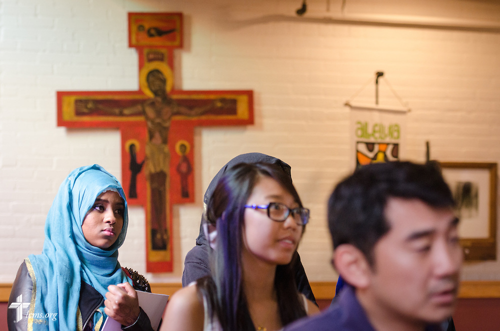 A student stands during chapel service in Graebner Memorial Chapel on the campus of Concordia University, Saint Paul, on Wednesday, August 6, 2014, in St. Paul, Minn.   LCMS Communications/Erik M. Lunsford