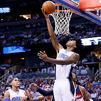 28 October 2015: Orlando Magic guard Elfrid Payton (4) goes for the reverse layup during the Washington Wizards 88-87 victory over the Orlando Magic, at the Amway Center, in Orlando, Florida, USA.