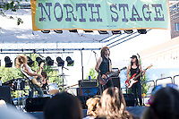 Photographs of rock and roll band, Shim playing at the North stage at the 2008 West Seattle Street Fair.