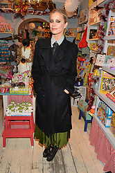 LONDON, ENGLAND 1 DECEMBER 2016:Left to right, Laura Bailey at the 10th birthday party for the toy shop HoneyJam, 2 Blenheim Crescent, Notting Hill, London, England. 1 December 2016.