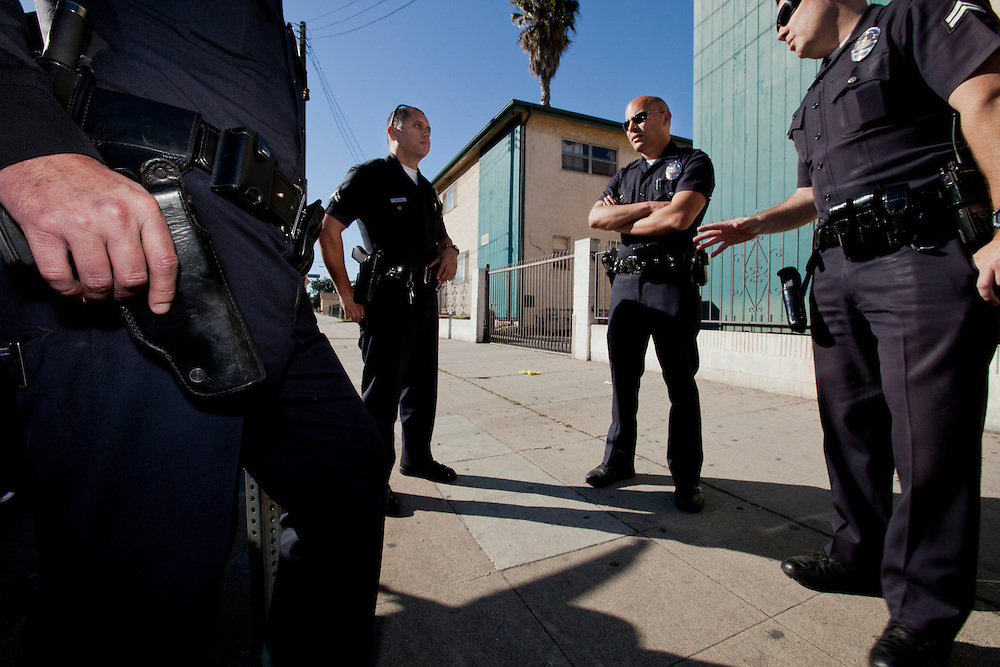 Los Angeles police officers converse after detaining a suspect on Feb. 3, 2011. Los Angeles, Calif. (photo by Gabriel Romero ©2011)