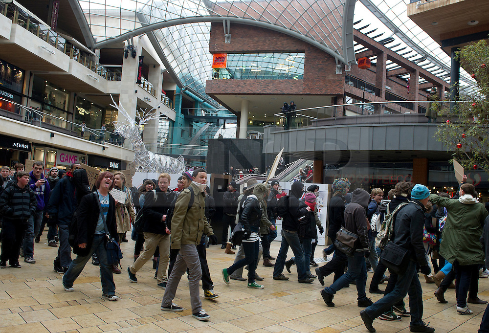 © under license to London News Pictures. 30/11/2010 Students march through the Cabot Circus shopping centre today (Tuesday). Demonstrations all over the UK are taking place to protest against proposed higher education fees. Credit should read: David Hedges/LNP