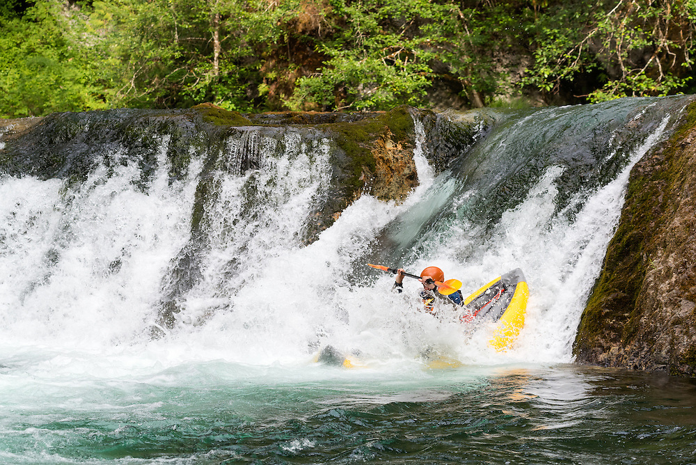 Running Salmon Creek Falls in an inflatable kayak, Oregon.