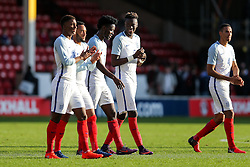 Tammy Abraham of England U21 shares a joke with his teammates after scoring twice in a 5-0 win - Rogan Thomson/JMP - 11/10/2016 - FOOTBALL - Bescot Stadium - Walsall, England - England U21 v Bosnia and Herzegovina - UEFA European Under 21 Championship Qualifying.