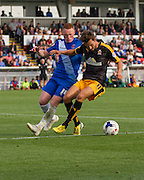 Harrison Dunk (Cambridge United) retains the ball under pressure from Michael Woods (Hartlepool United) during the Sky Bet League 2 match between Hartlepool United and Cambridge United at Victoria Park, Hartlepool, England on 19 September 2015. Photo by George Ledger.
