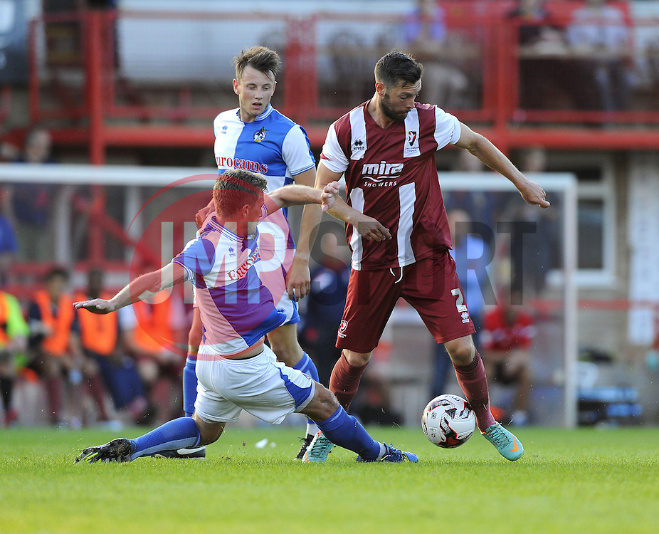 Bristol Rovers' Lee Mansell battles for the ball with Cheltenham Town's Andy Haworth - Photo mandatory by-line: Joe Meredith/JMP - Mobile: 07966 386802 15/07/2014 - SPORT - FOOTBALL - Bristol - Whaddon Road - Cheltenham Town v  Bristol Rovers