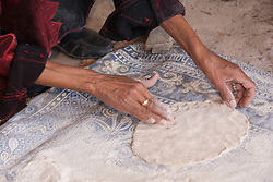 Middle East, Israel, Laqiya, Bedouin woman pressing dough for flatbread