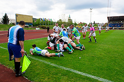 Players of Slovenia score with a try during rugby match between National team of Slovenia (green) and Bulgaria (white) at EUROPEAN NATIONS CUP 2012-2014 of C group 2nd division, on April 12, 2014, at ZAK Stadium, Ljubljana, Slovenia. (Photo by Matic Klansek Velej / Sportida.com)