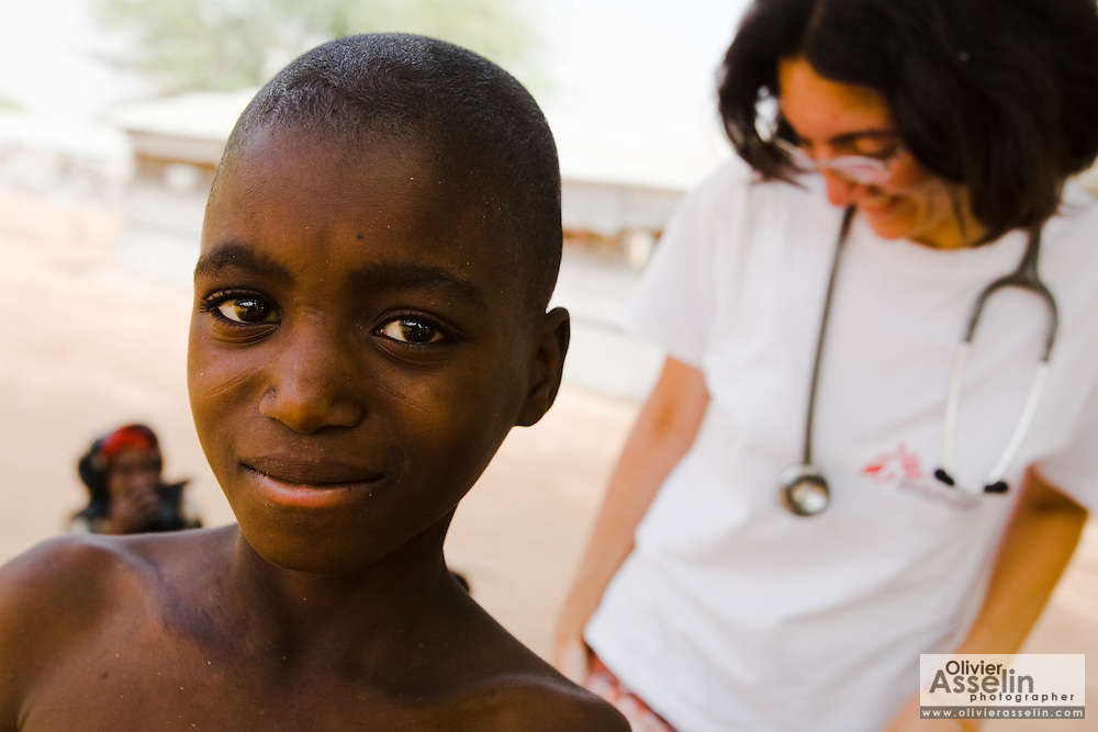 Mahaboube Achirou, 12, at the Aguie district hospital in the town of Aguie, roughly 80 km east of Maradi, Niger on Friday April 17, 2009. Mahaboube was infected with meningitis but has now almost entirely recoverd. At right is MSF Beligum doctor Emma Manfrin.