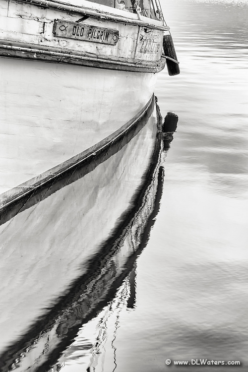 Black and white photo of a fishing trawler in Wancheese NCon the Outer Banks.