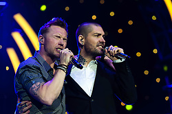 "© Licensed to London News Pictures. 26/01/2013. London, UK.   Ronan Keating (left) and fellow Boyzone bandmate Shane Lynch (right) performing live during the encore of Ronan Keating's solo gig at The O2 Arena.  Ronan and Shane had just announced plans for Boyzone to tour the UK later in the year.  Ronan is currently touring to promote his ninth studio album, ""Fires"".  Ronan Keating is an Irish recording artist, singer-songwriter, musician, and philanthropist.  His solo career started in 1999.  Keating debuted on the professional music scene alongside Keith Duffy, Mikey Graham, Shane Lynch and Stephen Gately, in 1994 as the lead singer of Irish group Boyzone.  Photo credit : Richard Isaac/LNP"