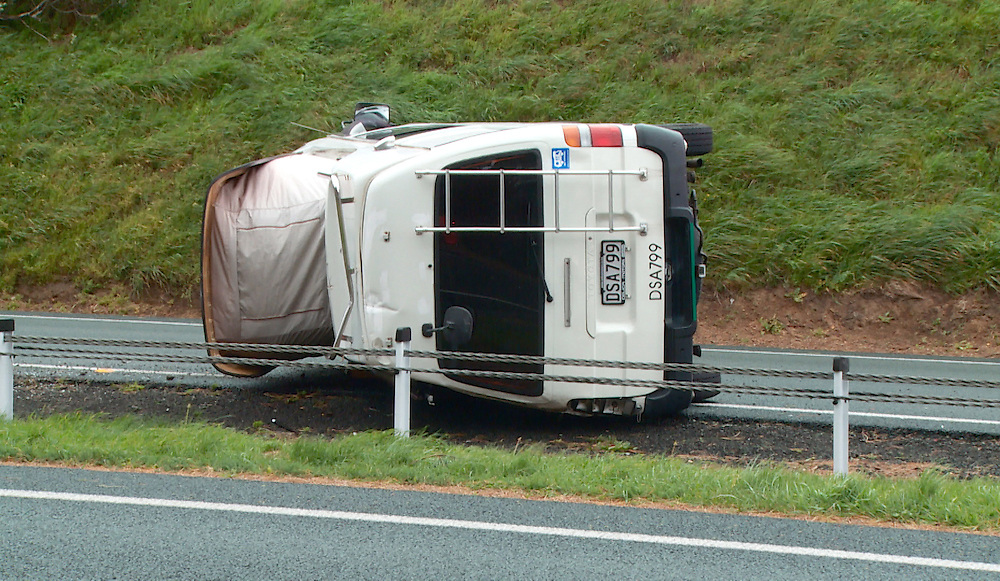 A campervan lies on it side after being blown over on the SH1 motorway north of Johnsonville as winds lashed the capital, Wellington, New Zealand, Friday, September 13, 2013. Credit:SNPA / Sam James **BEST AVAILABLE QUALITY**VIDEO GRAB**
