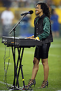 Pianist and singer Amanda Vernon sings and plays the National Anthem before the Green Bay Packers 2015 NFL week 3 regular season football game against the Kansas City Chiefs on Monday, Sept. 28, 2015 in Green Bay, Wis. The Packers won the game 38-28. (©Paul Anthony Spinelli)