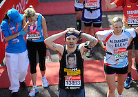 Releif at the finish<br /> The Virgin Money London Marathon 2014<br /> 13 April 2014<br /> Photo: Javier Garcia/Virgin Money London Marathon<br /> media@london-marathon.co.uk