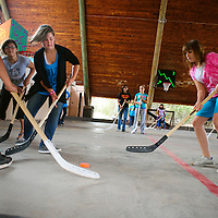 070513  Adron Gardner/Independent<br /> <br /> Campers at the Broken Arrow Bible Ranch vie for the puck in a hockey game near Vanderwagen Friday.