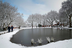 © Licensed to London News Pictures.30/1/2015. Baddersley, Warwickshire. Snow fell in Warwickshire overnight. Pictured, a frozen pond in the centre of Baddersley.<br /> Photo credit : Dave Warren/LNP