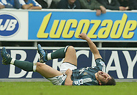 Photo: Aidan Ellis.<br /> Wigan Athletic v Newcastle United. The Barclays Premiership. 15/10/2005.<br /> Newcastle's Emre feels the challenge from Wigan's Lee McCulloch for which he was sent off